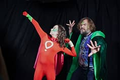 Jack Black and a champion posing as super heroes